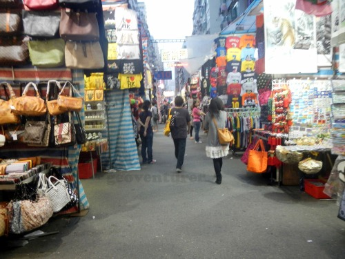 The Mong Kok Ladies Market is not as crowded in the early weekday evening