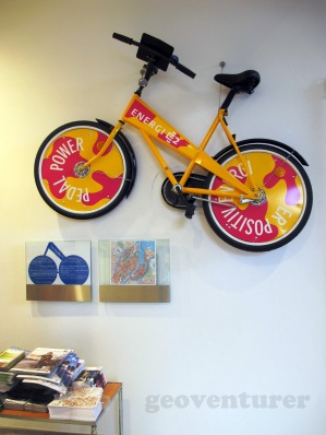 Pedal power! - bike hanging on the wall at the tourist center
